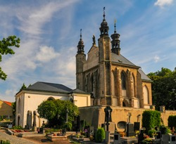 Exterior of the Sedlec Ossuary (Kostnice Sedlec) in Kutna Hora, Czech Republic at sunny summer day. World famous gothic chapel whose interior is decorated with human bones.