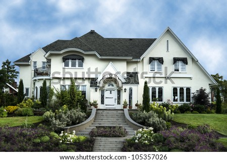 Exterior Home Design on Exterior Of White Stucco Luxury House With Landscaped Yard Stock Photo