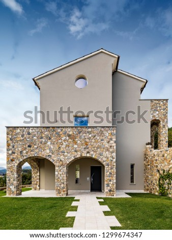 exterior shot of a modern villa with porch #1299674347