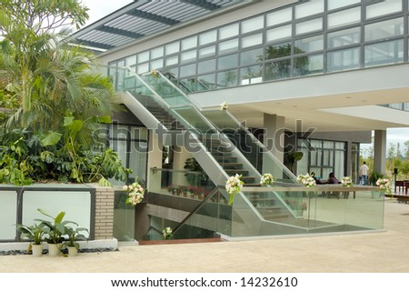 Exterior Staircase and glass wall viewed from a opening hall