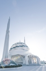 Exterior structure of Marmara university theology faculty mosque with a few muslims walking. Futuristic mosques and buildings in Europe.Turkey. Background image.