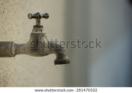 Exterior tap water dripping. Tap water leaks.