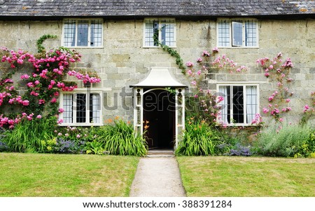 Exterior View and Garden Lawn of a Picturesque Old Rural English Cottage