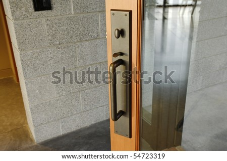 Exterior View Of A Brass Door Handle With Turning Lock