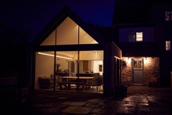 Exterior View Of Beautiful Kitchen Extension At Night