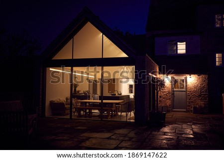 Exterior View Of Beautiful Kitchen Extension At Night Stockfoto ©