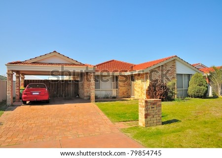 Exterior view of generic house with car in garage. - stock photo