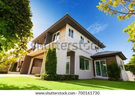 Exterior view of house with green grass.Home For Sale,Rent,Housing and Real Estate concept. #700161730