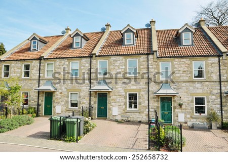 Exterior View of Terraced Stone Cottages on a Street in a Typical English Town #252658732