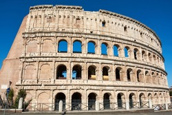 Exterior view of the Roman Colosseum or Flavian Amphitheatre, an ancient structure which is the biggest amphitheatre built by the Roman Empire. One of the seven wonders of the world.