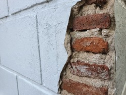 Exterior wall cracks such as cracks in the brickwork, surface or rendering of external walls.Cracks in foundation walls.