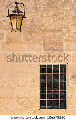 Exterior with decorated window and wall lamp in the historic site of Mdina (The city of Silence) on Malta.