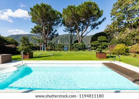 Exterior with swimming pool, garden and lake view. Nobody inside #1194811180