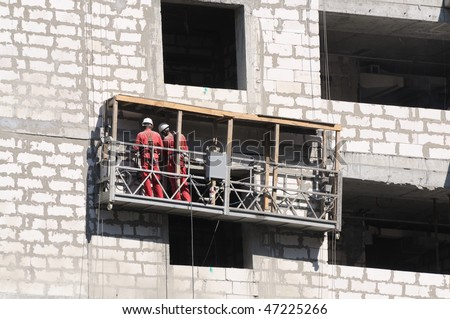 Exterior work at an unfinished building