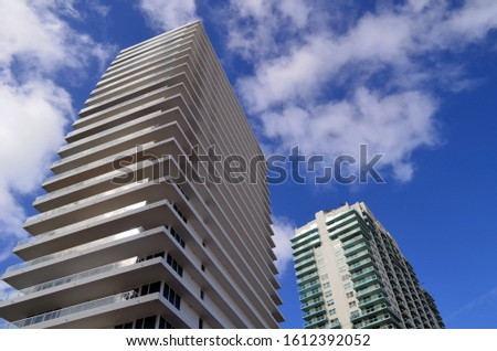 Exteriors of two luxury condo towers in southeast Florida