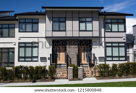 External facade of a row of colorful modern urban townhouses.brand new houses just after construction on real estate market
