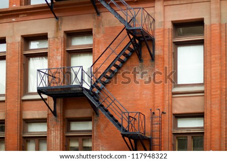 External fire escape staircase on an old brick building