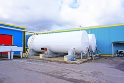 External fuel tanks at a filling station. Close - up of grain storage tanks