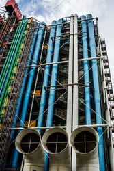 External installations, structure and colored pipelines making the facade of a building