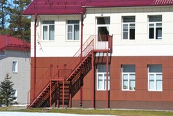 External staircase on the facade of the sanatorium building. Fire escape outdoor stairs. Emergency Stairs.