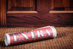 Extra Extra look inside headlines on a rolled vintage style newspaper, paper has newsprint texture