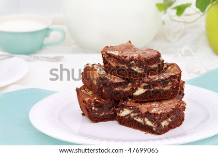 Extra moist cream cheese chocolate brownie against a beautiful blue and white background.