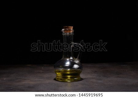 Extra virgin healthy Olive oil with fresh olives on dark wooden background #1445919695