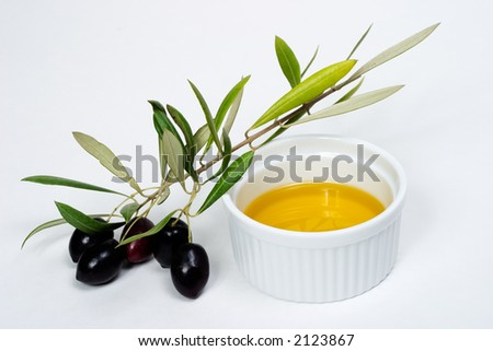 Extra-virgin olive oil and black olives branch