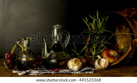 Extra virgin olive oil in vintage bottles and spices and seasonings in an old rustic kitchen, old style still life