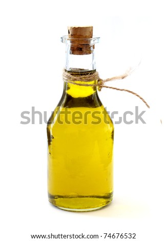 Extra Virgin Olive Oil over white - stock photo