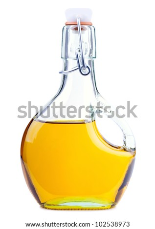 Extra virgin rapeseed oil in a bottle isolated on white