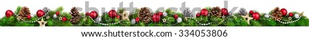 Extra wide Christmas border with fir branches, red and silver baubles, pine cones and other ornaments, isolated on white #334053806