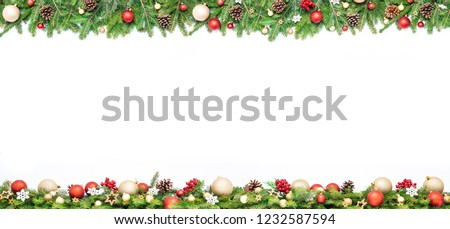 Extra wide Christmas border with golden and red baubles, fir branches, pine cones and red rowan isolated on white background. #1232587594