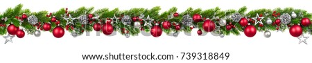 Extra wide Christmas border with hanging garland of fir branches, red and silver baubles, pine cones and other ornaments, isolated on white