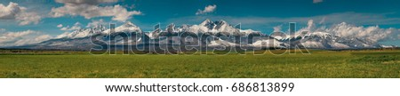 Extra wide panorama of High Tatra mountains during April with snowy hills / Vysoke Tatry / Slovakia