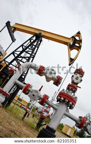 extraction of oil. pump jack and oil well. Western Siberia. Russia.