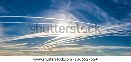 Extraordinary number of aircraft contrails against the sun,under cool clear and windless conditions on a March spring day over Spain.  These reduce the sunlight and are destroying the ozone layer. #1366527524