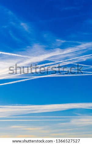 Extraordinary number of aircraft contrails against the sun,under cool clear and windless conditions on a March spring day over Spain.  These reduce the sunlight and are destroying the ozone layer. #1366527527