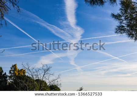 Extraordinary number of aircraft contrails against the sun,under cool clear and windless conditions on a March spring day over Spain.  These reduce the sunlight and are destroying the ozone layer. #1366527533