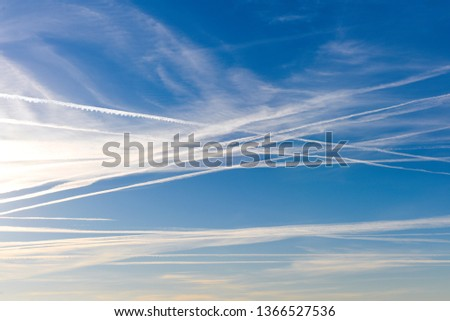 Extraordinary number of aircraft contrails against the sun,under cool clear and windless conditions on a March spring day over Spain.  These reduce the sunlight and are destroying the ozone layer. #1366527536
