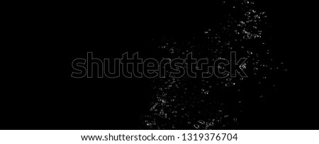 Extream close-up images of water bubbles or soda or liquid texture that splashing and floating up to surface like a explosion in black color background for refreshing carbonate drink concept. #1319376704