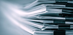extreamely close up a report paper stacking of office working document , retro color tone