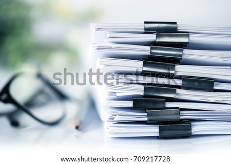 extreamely close up  stacking of office working document with paper clip folder #709217728