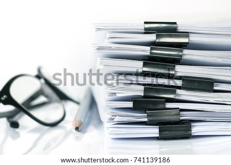 extreamely close up  stacking of office working document with paper clip folder, vintage color tone #741139186