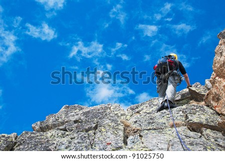 Extreem sport. Climber on the mountain summit