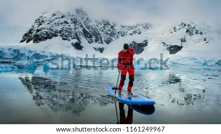 Stock Photo extreme adventure sport, Antarctica kayaking, paddling on kayak between antarctic icebergs, winter leisure outdoors activity