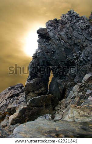 extreme and terrible mountain rock during a sunset