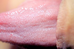 extreme close up human toungue show details of the taste buds