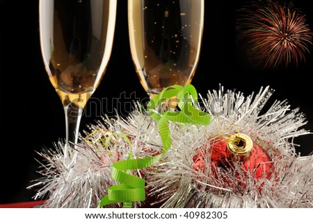 Extreme close-up image of Champagne flutes and Christmas setting