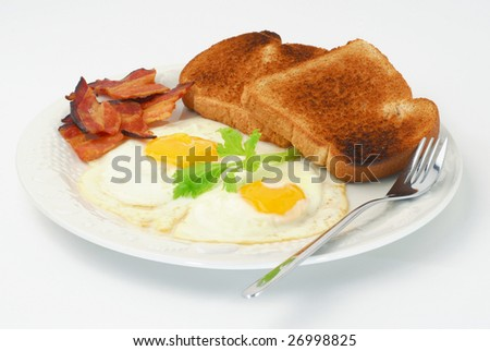 Extreme close-up image of fried eggs in a plate